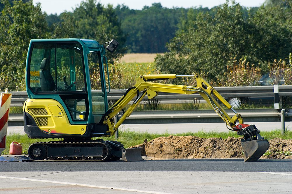 mini excavator on  motorway